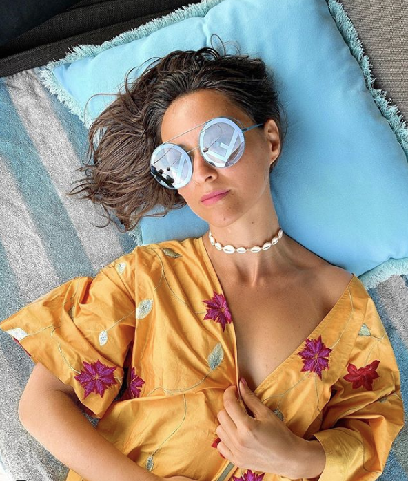 a bright island or tropical look accented with pastel blue sunglasses with F monograms for Fendi