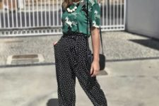 a bright look with a green printed tee, black polka dot cropped pants, green and black sandals and a black bag