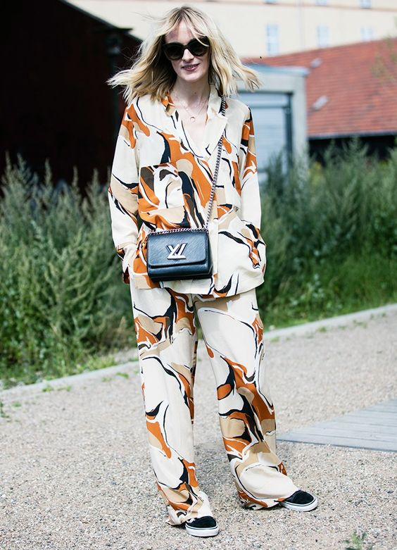 a bright oversized pajama suit, a black crossbody and black slipons for a bold look