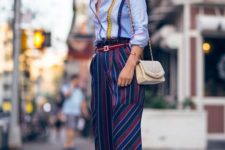 a bright striped shirt, bold striped cropped pants, block heels and a neutral bag for a party