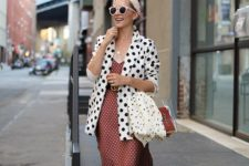 a burgundy polka dot midi dress, a polka dot overiszed blazer, pearly slippers and a headband
