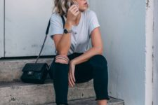 a casual look with a grey tee, black ripped skinnies, a black crossbody and orange minimalist heels for a touch of color