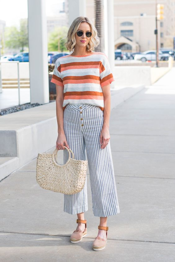a casual look with a striped t shirt, striped culottes, pastel espadrilles and a woven bag