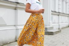 a casual look with a white printed tee, a yellow floral midi, white sneakers is perfect for every day