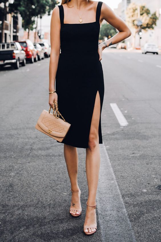 a chic black sheath knee dress with a slit, tan minimalist heels and a blush bag for a party look