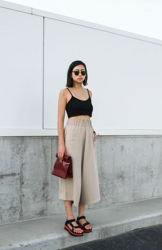 a comfortable everyday look with a black crop top, neutral linen culottes, black sporty sandals and a brown bag