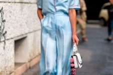 a contrasting look with a light blue and red pajamas suit, a white bag with a floral handle looks wow