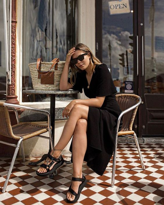 a cool summer look with a black midi wrap dress, black sporty sandals, a woven bag is great