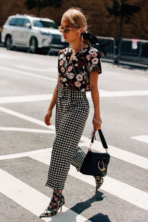 a dark floral shirt, plaid high waisted culottes and a black bag to go to work