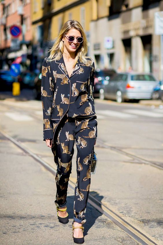 a gorgeous look with a black cat printed pajamas suit, black and gold shoes and a clear bag