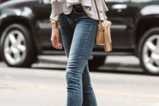 a grey layered tiered top, blue cropped skinnies and dove grey minimalist heeled sandals plus a neutral bag