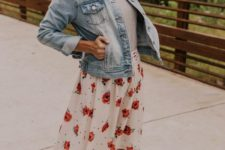 a grey tee, a rose print skirt, a blue denim jacket and tan platform shoes