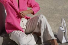 a hot pink blazer, white pants and a white bag for going to work in summer