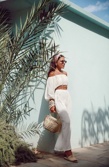 a monochromatic vacation look with a long sleeve crop top, wideleg pants, slippers and a wooden bag