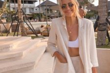a neutral oversized linen suit, a white bra crop top for a vacation look