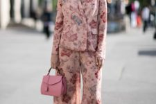 a pastel pink floral pajamas suit with cropped pants, pink floral shoes and a bright pink bag