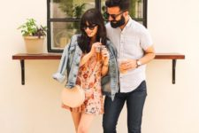 a pink floral mini dress, a blue denim jacket, blush sporty sandals and a round blush bag