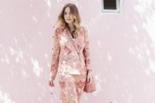 a pink floral pyjamas suit with white block heels and a pink bag for a comfy and chic look