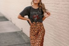 a printed tied up tee, a leopard print satin midi, white sneakers and a black bag