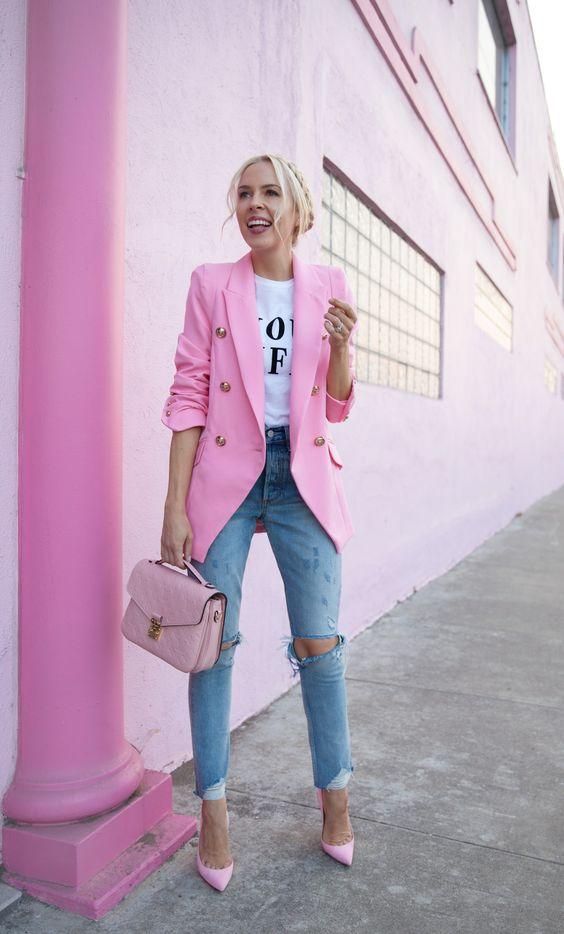 a printed white tee, blue ripped jeans, pink shoes, a hot pink blazer and a blush bag