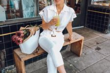 a retro-inspired look with a white tied up crop top, cropped skinnies, peachy square toe shoes and a white bag