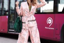 a romantic light pink floral pajamas suit with a green tee, silver shoes and a green bag