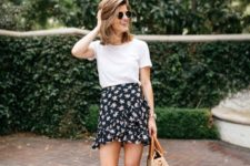 a romantic look with a white tee, a black floral wrap mini skirt, pink braided heels and a wicker bag