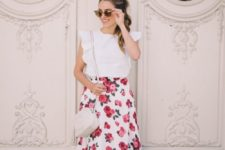 a romantic vintage outfit with a white ruffle top, a floral print skirt, tan shoes and a white bag
