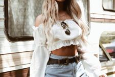a sexy summer look with a white off the shoulder crop top with long sleeves and blue high waisted shorts