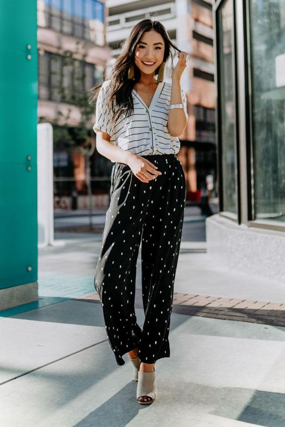 a striped button ip shirt, blakc polka dot pants, dove grey mules for a monochromatic summer look