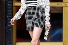 a striped top, plaid shorts, a polka dot shirt in the same color scheme, grene heels and a small clutch