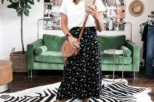 a stylish look with a white tee, a black floral midi skirt, brown block heels and a bag