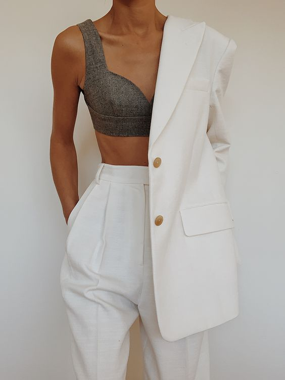 a stylish oversized creamy suit with a long blazer and high waisted pants plus a grey bra crop top