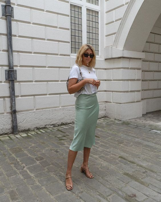 a summer look with a white tee, a light green satin midi, nude square toe heels and a small bag
