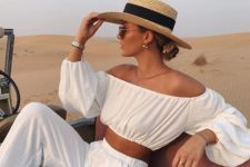 a vacation look in white with an off the shoulder crop top with long sleeves and wideleg pants