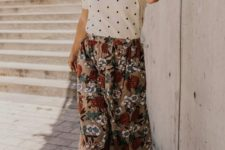 a vintage-inspired look with a polka dot top, a vintage floral midi skirt, a hat and tan shoes