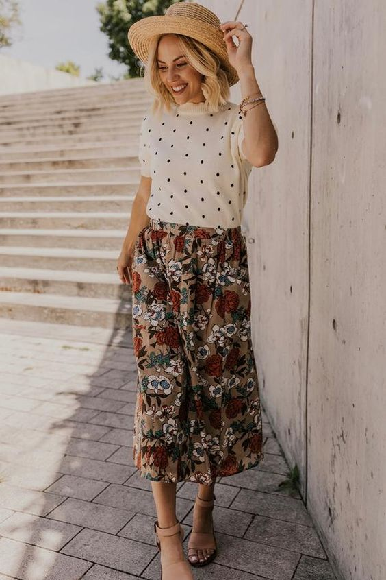 a vintage inspired look with a polka dot top, a vintage floral midi skirt, a hat and tan shoes