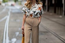 a whimsy printed shirt, polka dot pants, mustard mules and a matching bag for an extra bold look