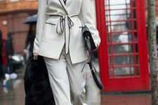 a white and black edge pajamas suit, a black bag and mules for a monochromatic look