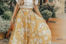 a white boho lace crop top, a yellow floral maxi A-line skirt, a hat, a brown bag and platform shoes