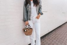 a white button up top, white jeans with a raw hem, white heels, a blue denim jacket and a wicker bag