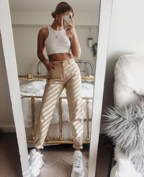 a white halter neckline crop top, tan jeans, white trainers for a comfy summer look