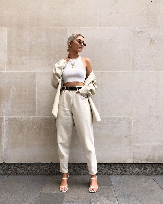 a white halter neckline top, a neutral linen pantsuit, white square toe shoes