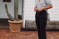 a white polka dot blouse, black jeans, black sporty sandals and a snake print bag