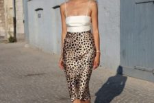 a white spaghetti strap top, a leopard print satin midi, nude strappy shoes for a hot look