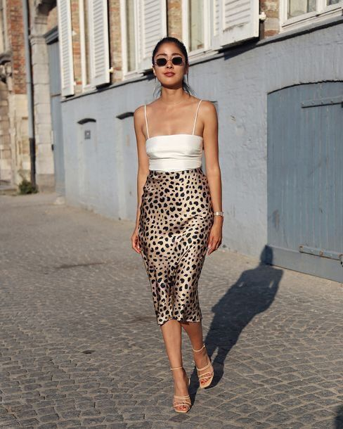 a white spaghetti strap top, a leopard print satin midi, nude strappy shoes for a hot look