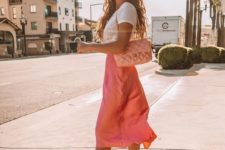 a white tee, a hot pink satin midi, white trainers and a pink bag for a glamed up look