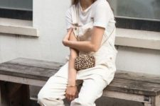 a white tee, a neutral overall, silver sporty sandals and an animal print bag for a chic and comfy outfit