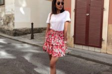 a white tee, a pink floral ruffle mini skirt, white trainers and layered necklaces