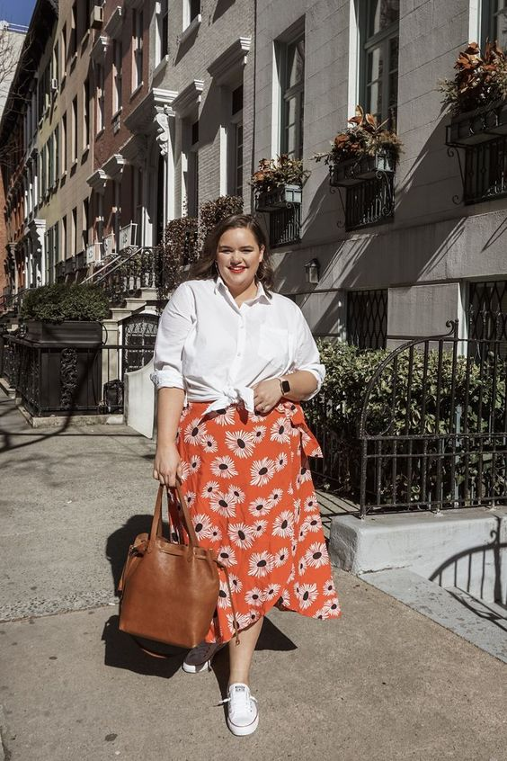 a white tied up shirt, an orange floral midi skirt, white sneakers and a brown tote for summer
